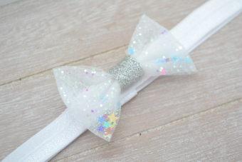 Collection Hiver noeud tulle blanc paillettes étoiles